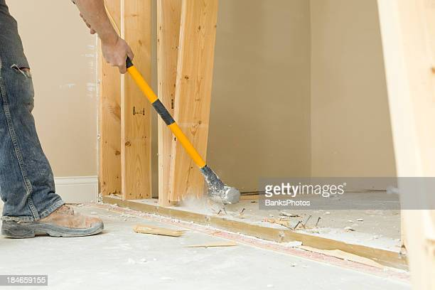 construction worker using a sledgehammer to remove wall stud - strip stock pictures, royalty-free photos & images