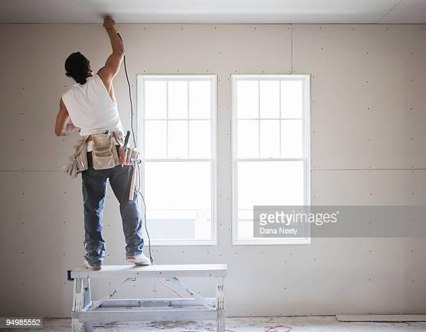 construction worker using drill - 住宅リフォーム ストックフォトと画像