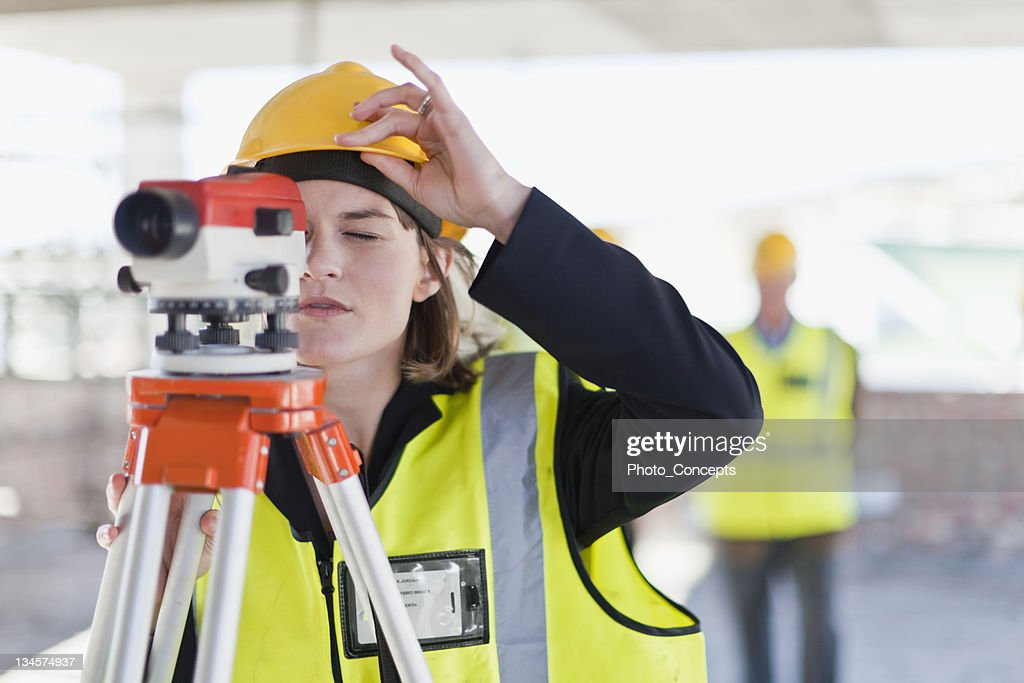 Construction worker using equipment : Stock Photo