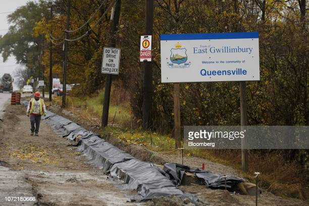 A construction worker walks on the side of a road in East Gwillimbury Ontario Canada on Friday Nov 2 2018 STCA Canada is scheduled to release new...