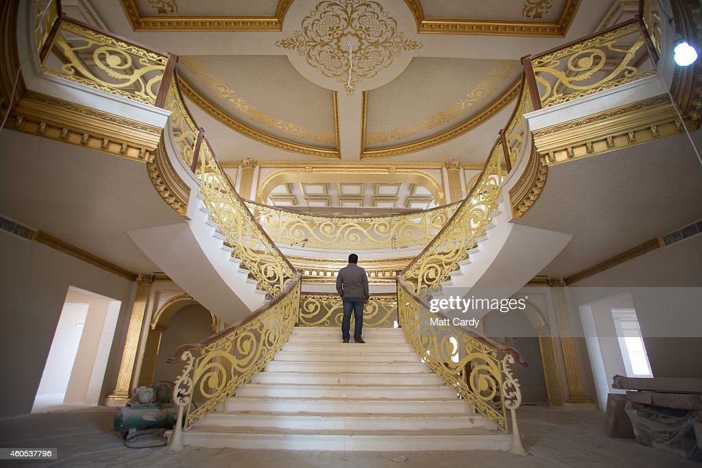 A construction worker walks up the staircase inside the replica White House, a $20million villa being built inside Dream City, a new exclusive residential suburb that is being developed in Erbil on December 15, 2014 in Erbil, Iraq. Dream City, is one of several high value residential areas that have been built in the Kurdistan capital since 2003 and are complete with their own mosque, shopping areas and schools. Property values vary, but many villas in the gated and walled development are now valued at over $1million and it even features a $20million US White House replica. Despite insecurity in the rest of Iraq, the semi autonomous region of Kurdistan has been seen by some investors as the new Dubai and although the advance of Islamic State and a budget row with Baghdad has dampened some of the enthusiasm, the city skyline is still changing at a rapid pace.