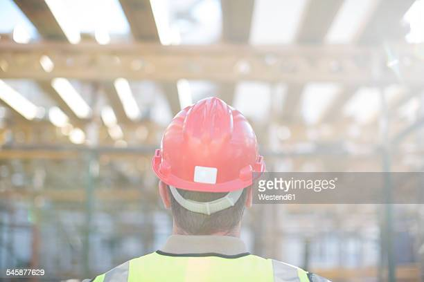 Construction worker wearing hard hat on construction site
