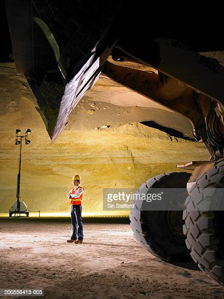 Construction worker wearing hardhat and vest in sand mine