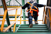 Construction worker wearing safety harness