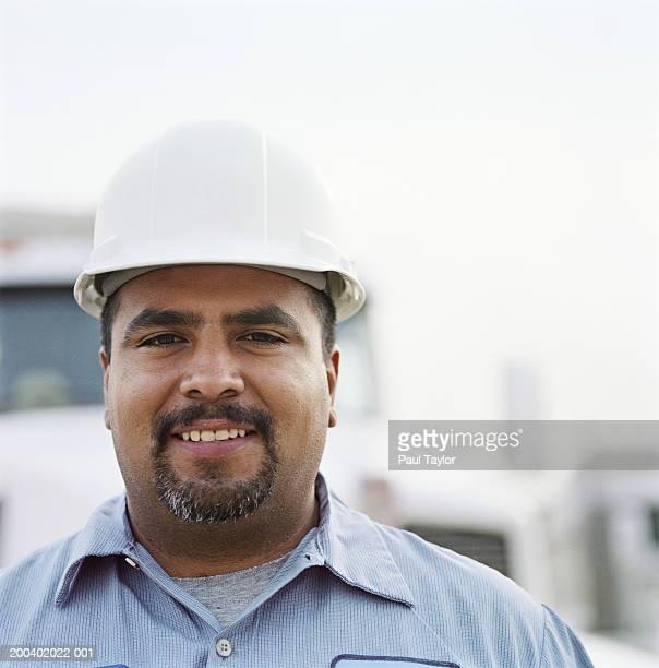 Construction worker wearing white hard hat, portrait