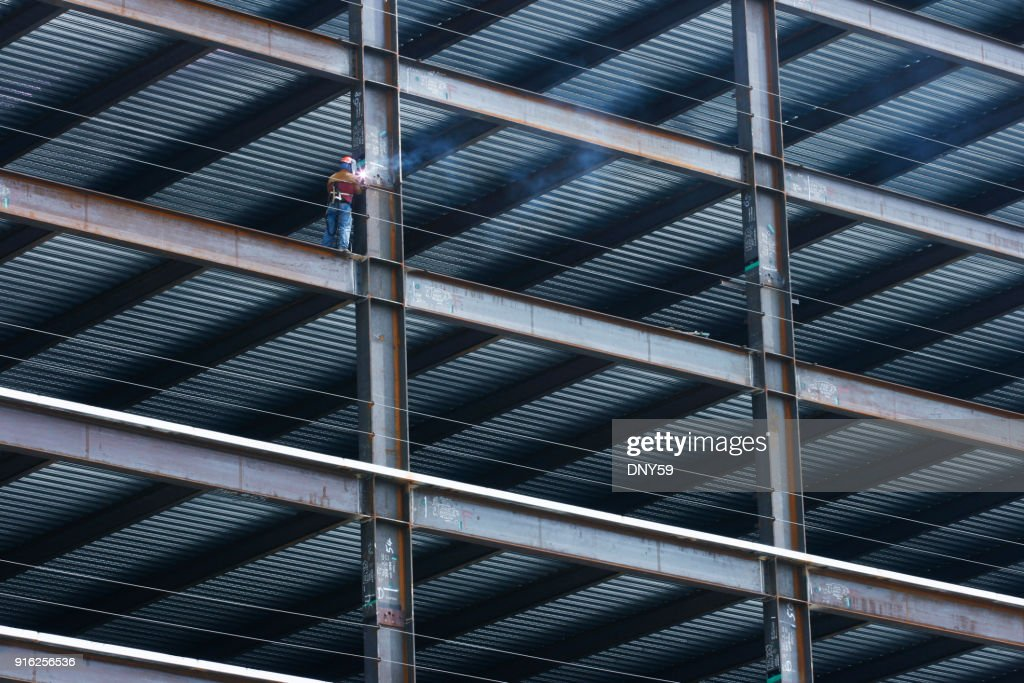 Construction Worker Welding Beam on High Rise Building : Stock Photo