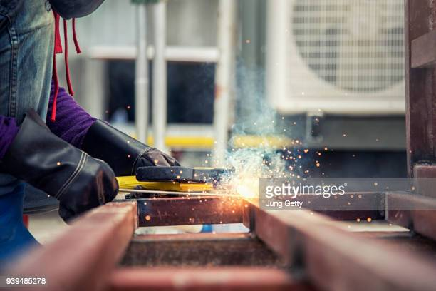 construction worker welding steel concrete form work in construction site in spec by civil and mechanical engineer - cloth face mask stock pictures, royalty-free photos & images