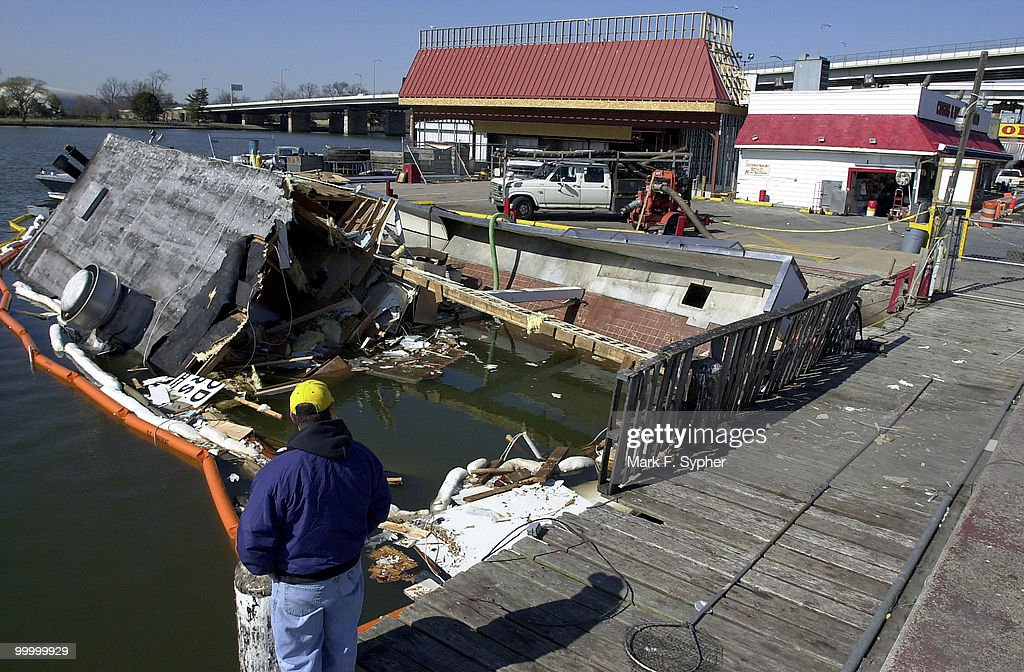 A construction worker, who wished to go unnamed, surveys the scene where the Custis Brown Fish Store used to float, until a fire about a week ago, at the Southwest Seafood Wharf, near Water and Maine Streets, SW.