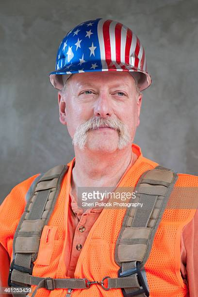 Construction Worker with American Flag Hard Hat