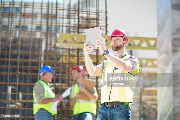 Construction worker with digital tablet in construction site