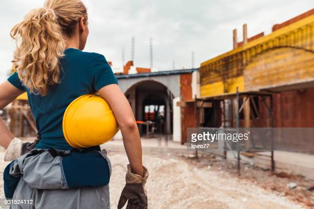 construction worker with hardhat in hand - foreman stock pictures, royalty-free photos & images