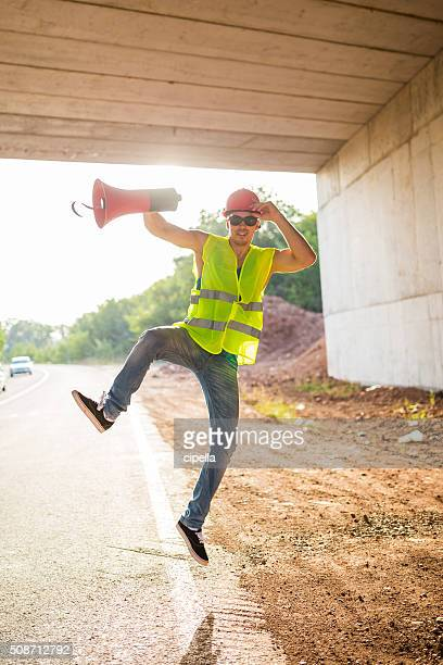 Construction worker with megaphone