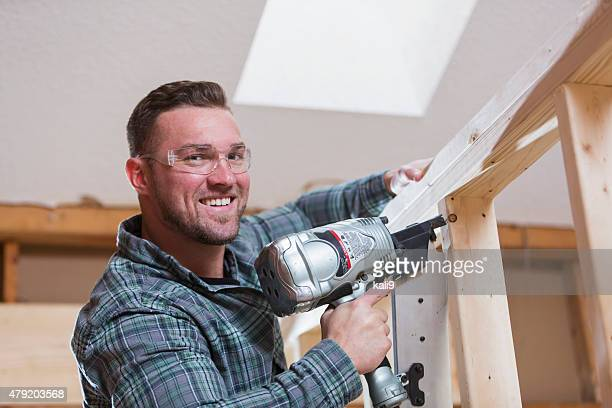Construction worker with nail gun