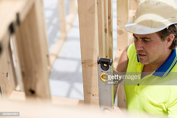 Construction worker with water scale