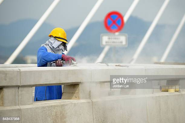 Construction worker work as Concrete grinder