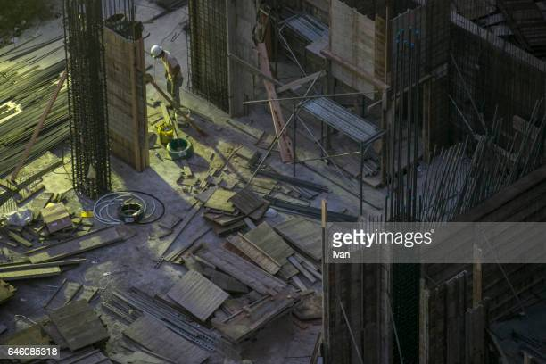 Construction Worker Working at Night