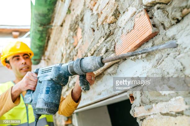 Construction worker working with jackhammer