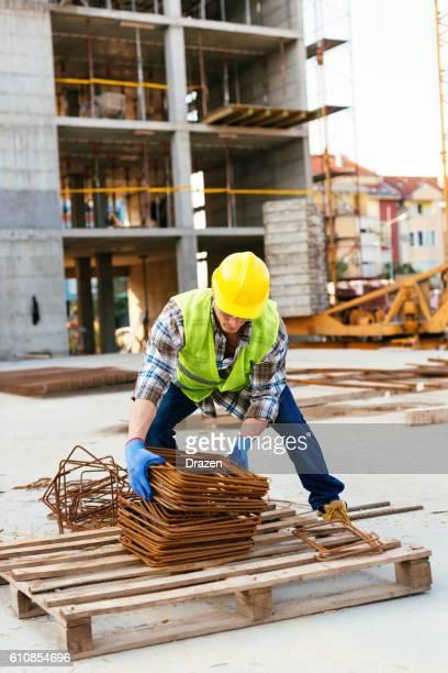 Construction worker works hard overtime