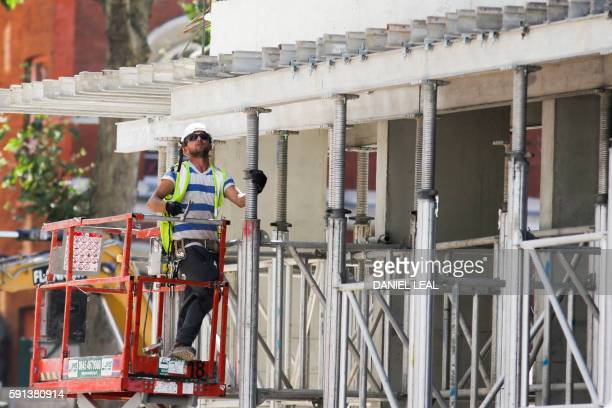 A construction worker works on a construction site in London on August 17 2016 From computers and cars to carpets and food Britain's decision to...