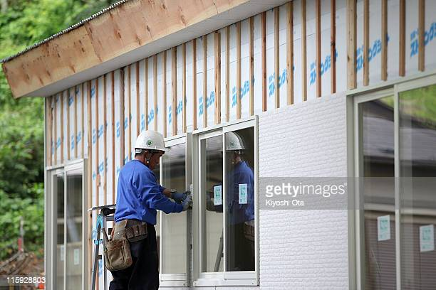 A construction worker works on temporary houses for evacuees who suffered from the March 11th earthquake and tsunami as seen on June 12 2011 in...