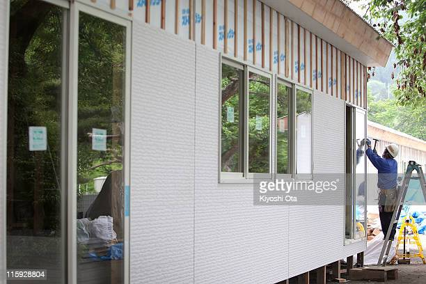 A construction worker works on temporary houses for evacuees who suffered from March 11th earthquake and tsunami on June 12 2011 in Otsuchi Iwate...