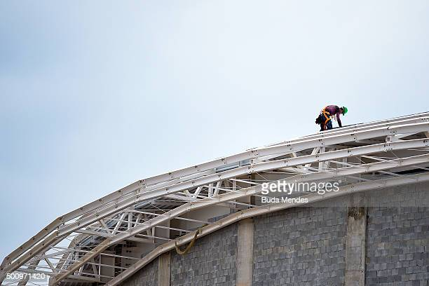 Construction worker works on the roof of the Rio Olympic Velodrome in preparation for the Rio 2016 Olympics at Olympic Park on December 11, 2015 in...