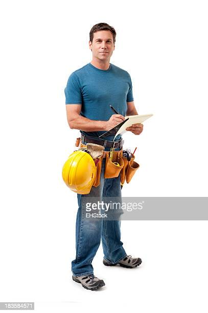 Construction worker writing on a clipboard