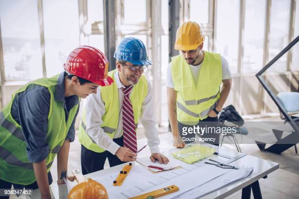 Construction workers and architects