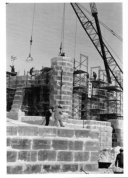Construction workers and cranes hoist up the Ice Palace of the 1986 St Paul Winter Carnival