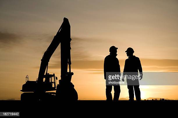 construction workers and equipment - excavator stock photos and pictures