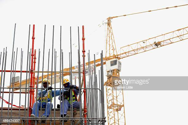 Construction workers are pictured on a building site on May 10 2014 in Doha Qatar
