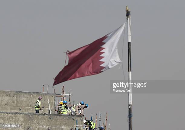 Construction workers are pictured on a building site on May 9 2014 in Doha Qatar