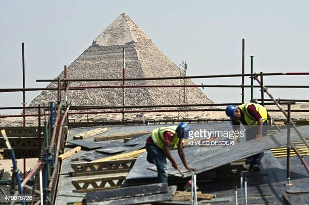 Construction workers are seen at the site of the new Grand Egyptian Museum near the Giza pyramids in Cairo on June 4 2015 Hundreds of artefacts never...