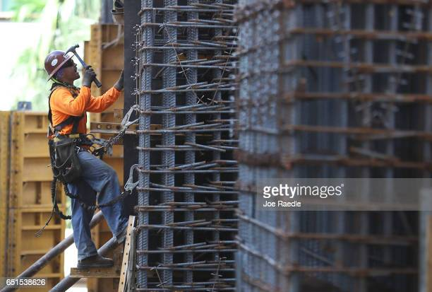 Construction workers are seen at work as the Bureau of Labor Statistics reports that nonfarm payrolls increased by 235000 in February and the...