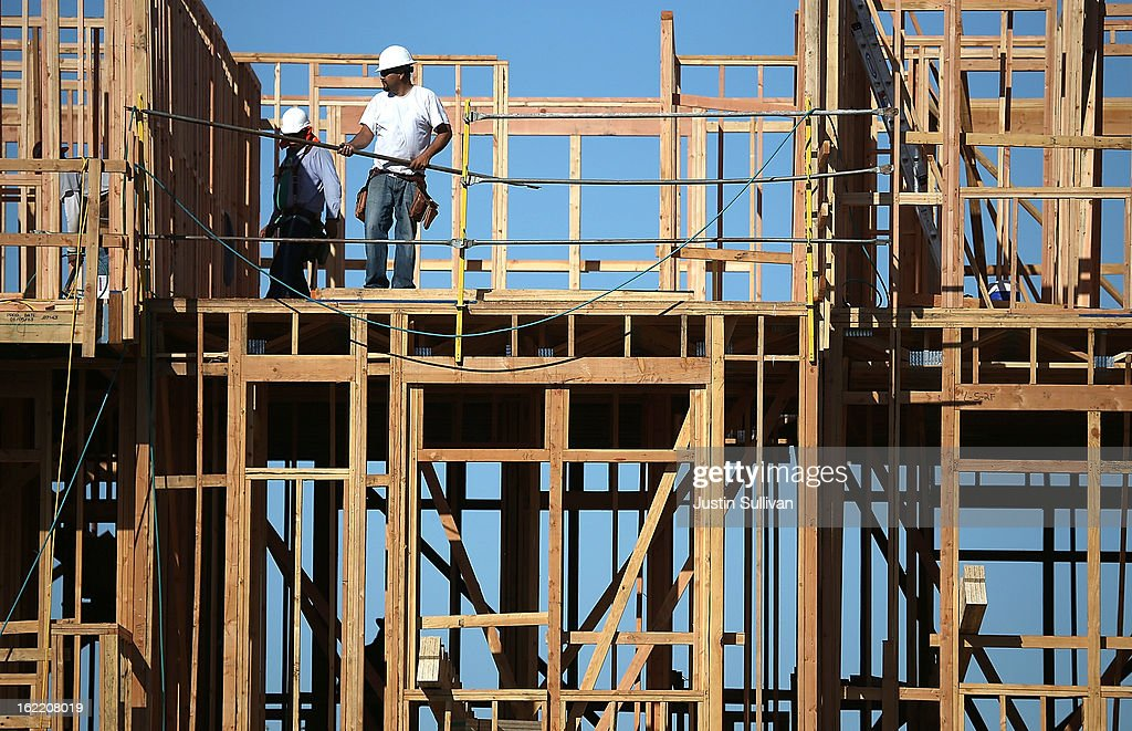 Construction workers are seen on the job at a new housing development on February 20, 2013 in San Mateo, California. The Commerce Department reported that new housing starts dropped 8.5% in January following a 15.7% increase one month earlier.