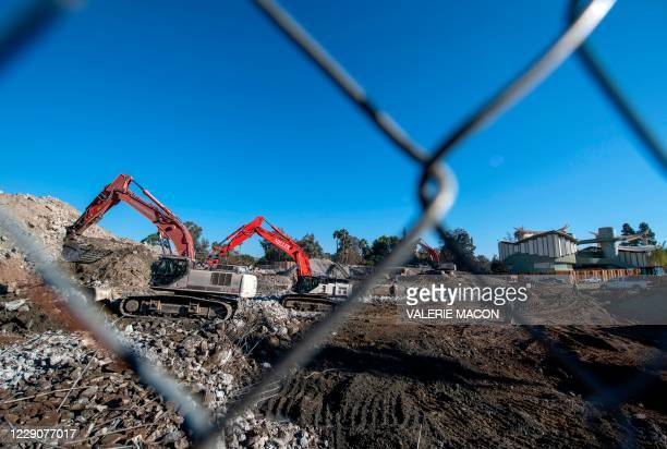 Construction workers are seen on the LACMA construction site, amid the coronavirus pandemic, October 14 in Los Angeles, California. - Four buildings...