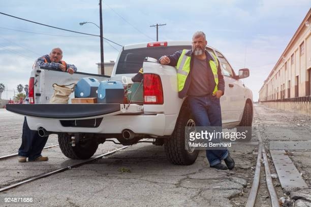 Construction workers are waiting at their pick-up truck