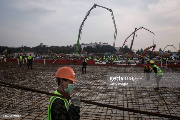 Construction workers as new hospitals are built to tackle the coronavirus on January 28 2020 in Wuhan China Wuhan Huoshenshan hospital will be...