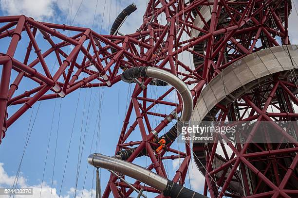 Construction workers assemble The Slide on the ArcelorMittal Orbit tower at the Queen Elizabeth Olympic Park on April 26 2016 in London England...