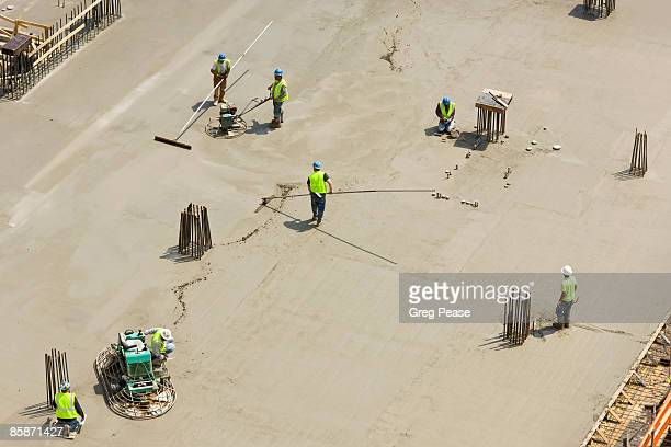 Construction Workers at High-rise Building Site