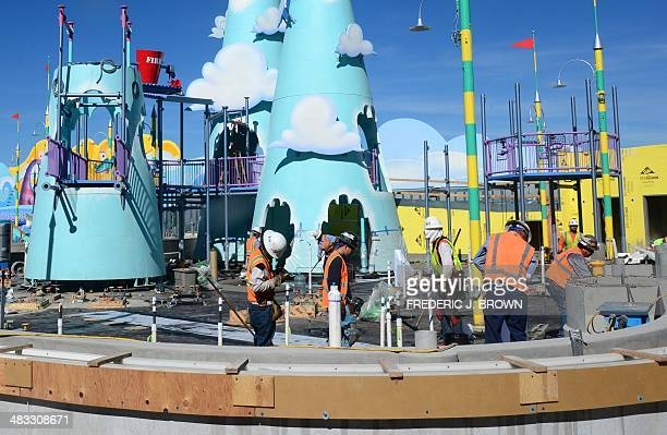 Construction workers at Universal Studios build in anticipation for more visitors around where the Despicable Me Minion Mayhem attraction was still...
