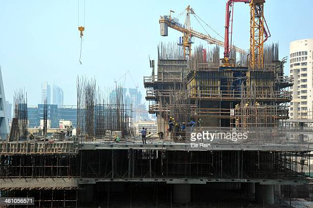 Construction workers at work. Mumbai , India. Massive construction works are going on in the city of Mumbai. As the city is always under constant...