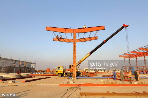 construction workers at work - amir mukhtar stock photos and pictures