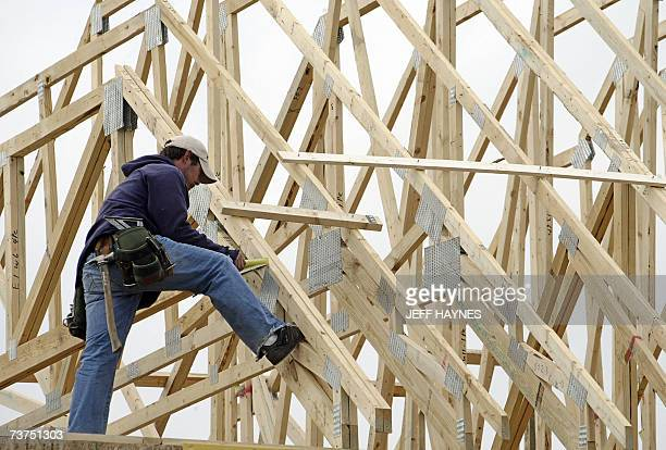 Construction workers build a new home 30 March 2007 at a new subdivision in North Aurora Illinois a suburb of Chicago Federal Reserve chairman Ben...