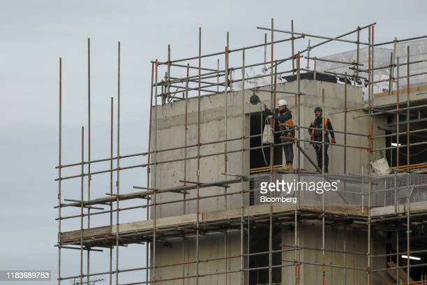 Construction workers build a new residential care block for elderly people on a Galliford Try Plc development in Camden north London UK on Wednesday...