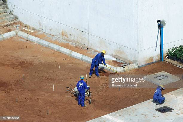 Construction workers build a road on a construction site on November 19 2015 in Maputo Mozambique