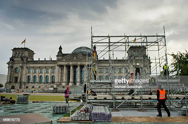 Construction Workers build a scaffolding in front of Reichstag Buliding of German parliament Bundestag on September 23 2015 in Berlin Germany
