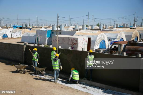Construction workers build a wall around the refugee camp Kabarto 2 in the district Semeel on April 23 2018 in DOHUK IRAQ The german goverment is...