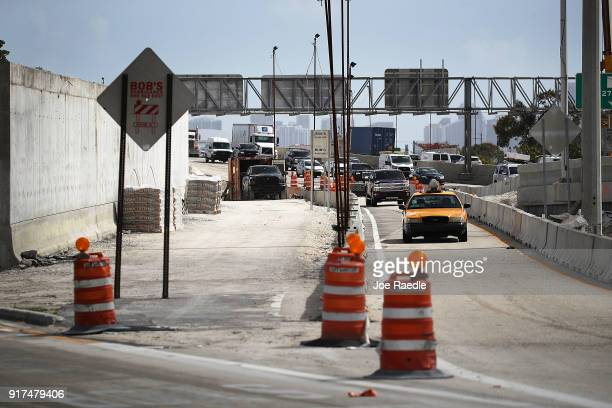 Construction workers build along State Road 836 on February 12 2018 in Miami Florida President Donald Trump announced his infrastrucure proposal...