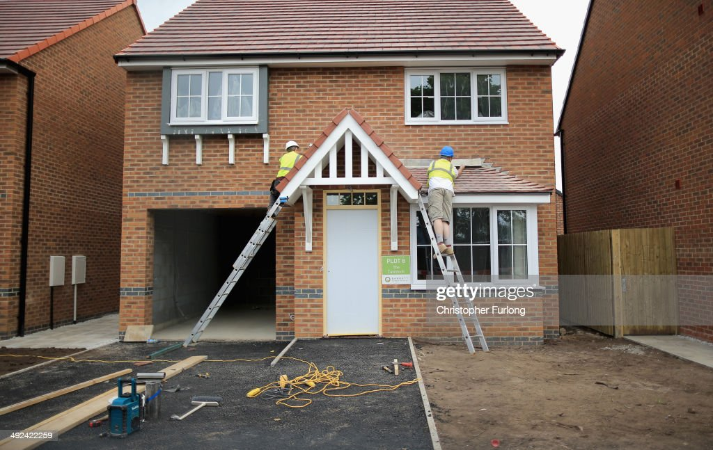 Construction workers build new houses on a housing development on May 20, 2014 in Middlewich, England. Official figures have shown that house prices have risen by 8% in the year ending in March. There have been calls by some experts for the UK Help to Buy scheme to be scaled down as it boosts the property market.